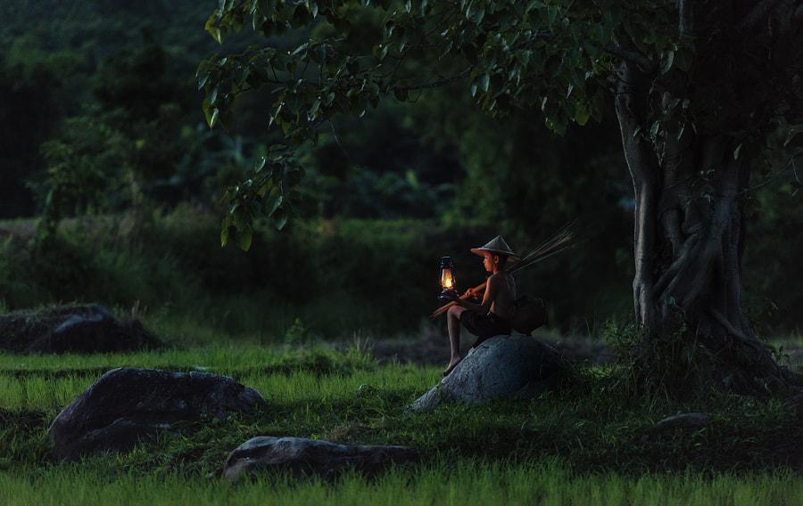 Boy fishing with lantern