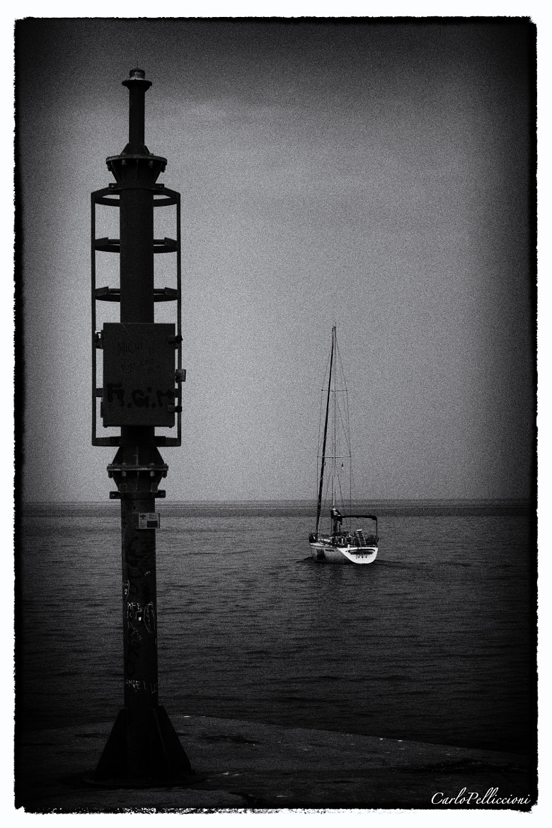 Photograph Il faro e la barca by Carlo Pelliccioni on 500px