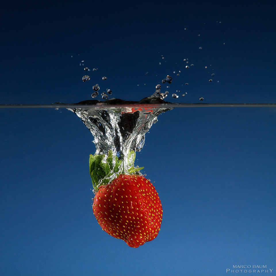 Photograph strawberry splash by Marco Baum on 500px
