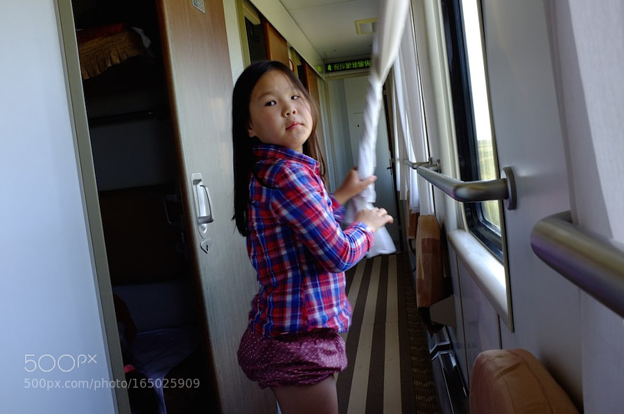 Little child inside the Trans Mongolian Railway train on the way to China.