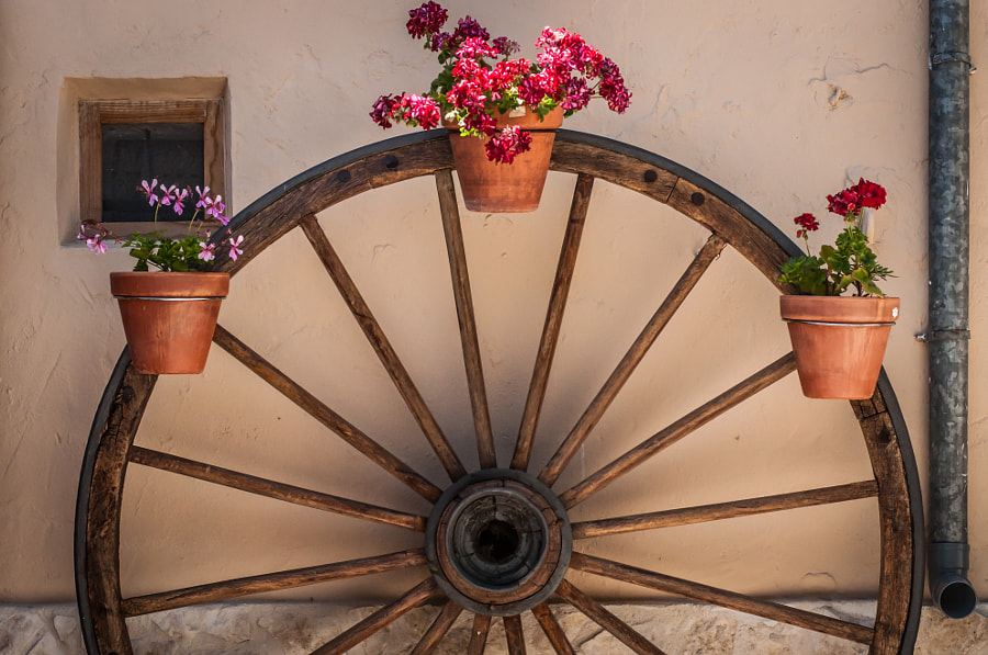 Old wheel in the town by Gustavo  Aragundi on 500px.com