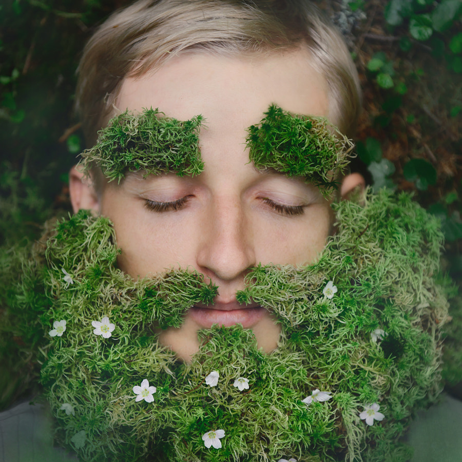 Sleeping hipster on grass with beard from moss by Nina Hilitukha on 500px.com