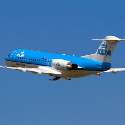 KLM Fokker 70 climbing out of Schiphol
