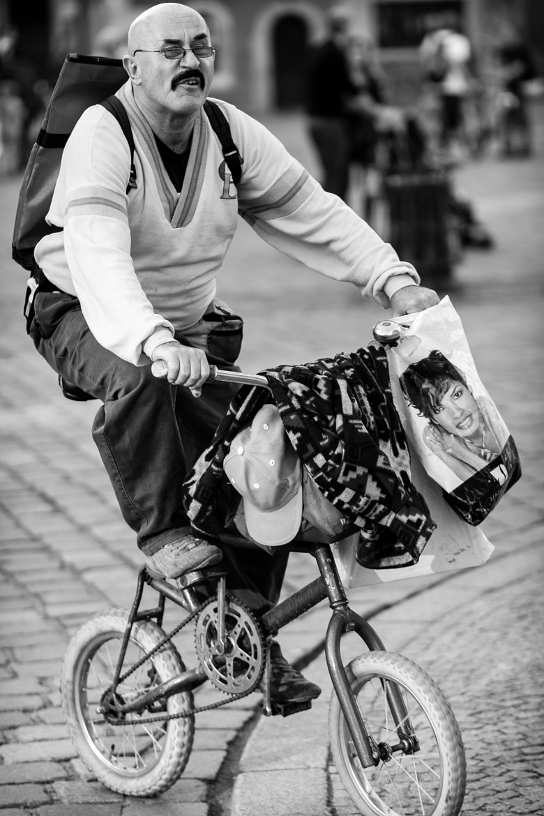 Photograph a guy on a small bicycle by Jakub Ostrowski on 500px