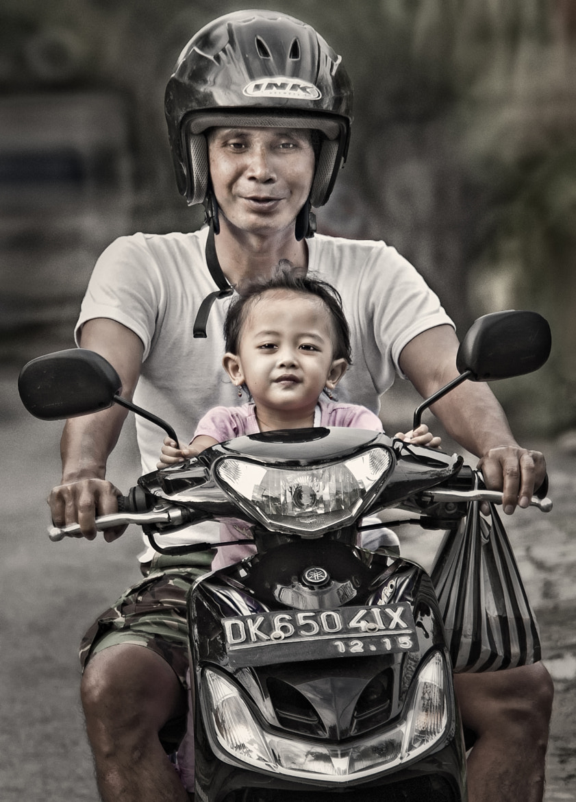 Photograph Balinese Father and Daughter by Tom Coyner on 500px