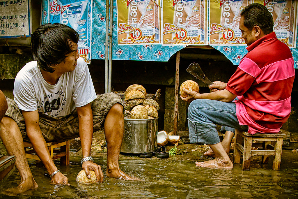 Photograph Cleaning Coconuts by Eric Elberson on 500px