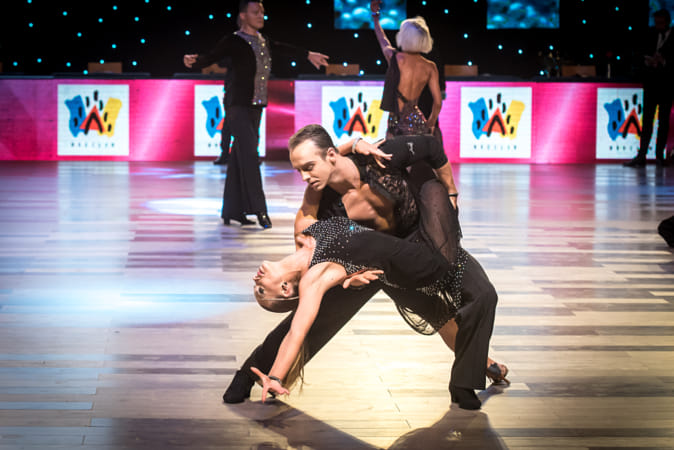 An unidentified dance couple dancing latin dance during World Dance Sport Federation...