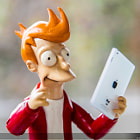 Постер, плакат: Fry recibe su Ipad mini