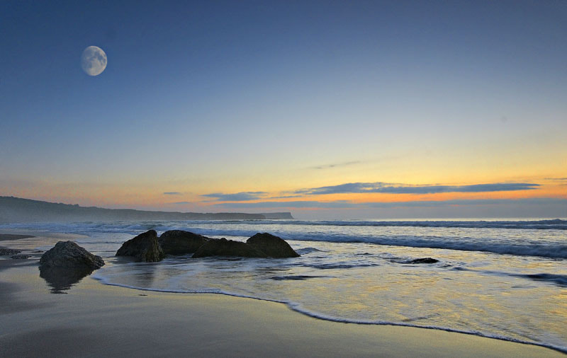 Photograph Moon over rocks by Brian Curran on 500px