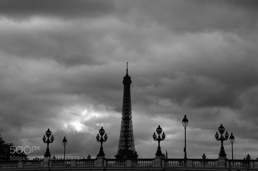 The Eiffel Tower and The Alexander III bridge.