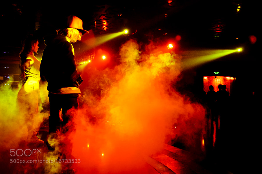 """Taken at the old lesbian club called Pao Pao club in Beijing during their midnight performance slot.   Every Friday I would come here, this is who i thought myself to be. Sure it wasn't the San Francisco or Los Angeles scene, but at that point in my life, I was in Beijing to stay for good, so I might as well get acquainted with """"my people.""""  Amazingly, after I read the book Repentance and Faith by Pastor Ock Soo Park 2 years ago, my life changed 180 degrees. one day i looked at my closet and it surprised me, why do i own so many guy clothes? now I am married to a man. Amazing book to say the least."""