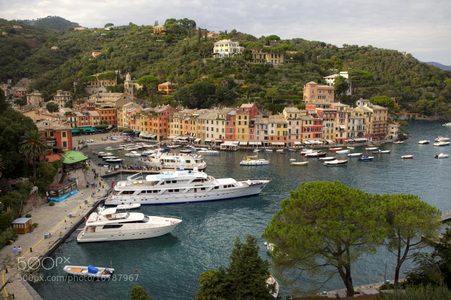 Portofino is an Italian fishing village, and upmarket resort famous for its picturesque harbour and historical association with celebrity visitors. It is a comune located in the province of Genoa on the Italian Riviera.