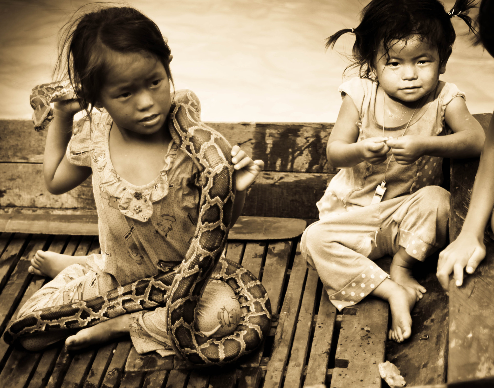 Photograph Girl holding snake by Craig L on 500px