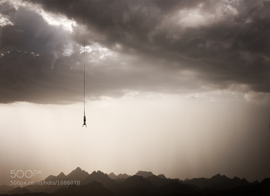 A few shots merged together. Clouds, Hatta Mountains in the UAE and Bungee jumper.