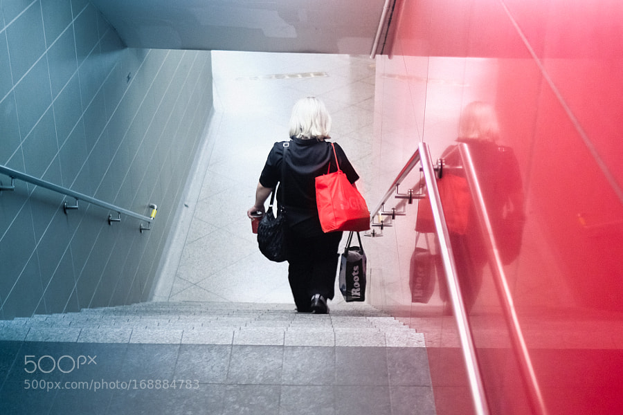 The lady with the red bag. Quick snap on my way down into St. Patrick station.