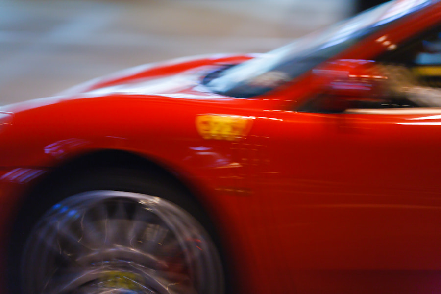 Photograph Red Ferrari Flying Through Chinatown by Tom Harrison on 500px