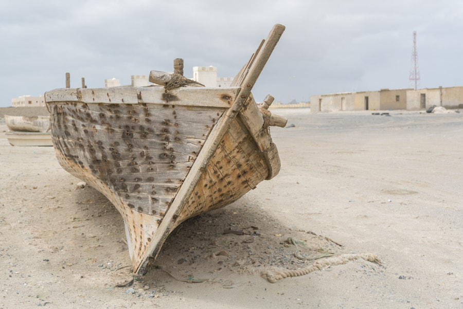 Wooden fishing boat on the sand