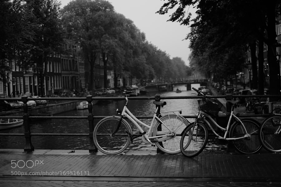 Bike at canal in Amsterdam 4