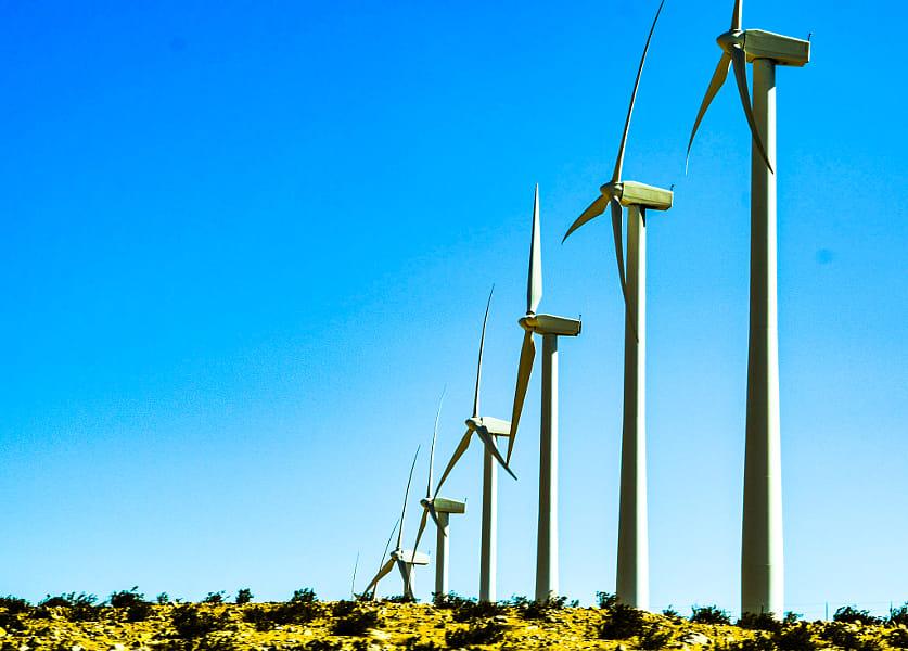 A desert landscape of windmills