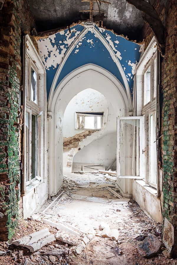 This European castle, built in the mid to late 19th century, has been left to decay for the last 20+ years.  Despite the great decay that has taken place here, walking through it one can see reminders of this castle's former glory: a grand staircase, vaulted ceilings, towers, etc.  Even now, the beauty of this place still manages to capture the imaginations and curiousities of urban explorers.