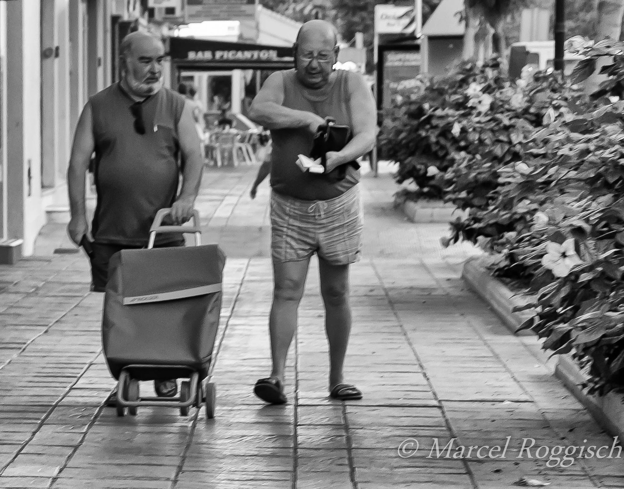 Photograph Two Men and a Trolly by Marcel  Roggisch on 500px