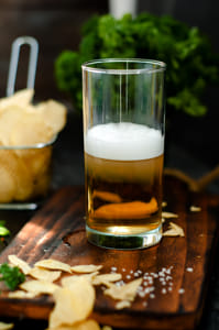 Mug of beer on wooden background by Alejandro Santiago on 500px