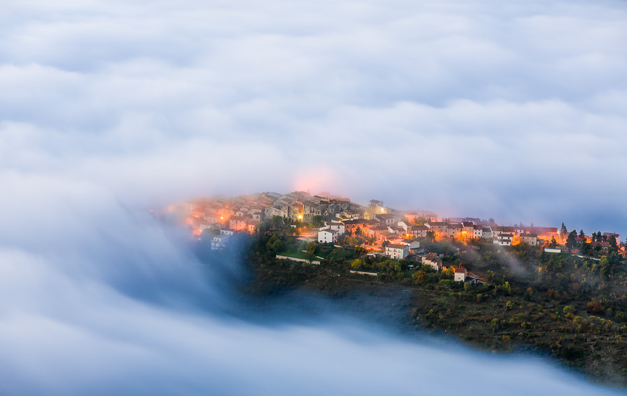 Photograph Castelvecchio Calvisio in morning clouds. by Hans Kruse on 500px