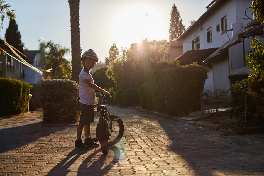 Portrait of cute boy with bicycle looking at camera by jenya pavlovski on 500px.com