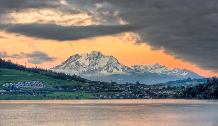 I shot this last October on my way to the office. The trees were still in color while the first snow had covered the nearby Mount Pilatus.  Oh, and btw: It's an HDR. 5 bracketed exposures on the tripod.