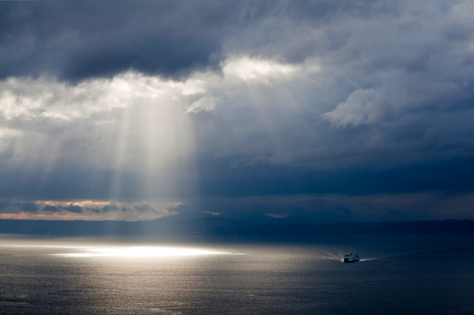 Photograph Pacific NW Puget Sound Sunrays and Ferry by Don  on 500px
