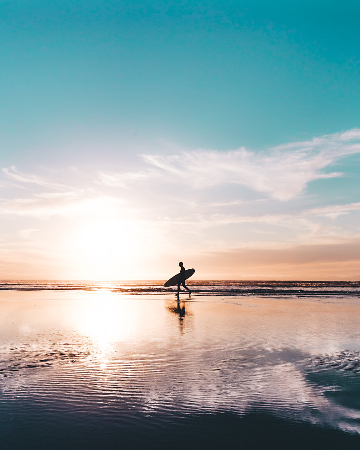 Surfer on the horizon by Ashley McKinney on 500px.com