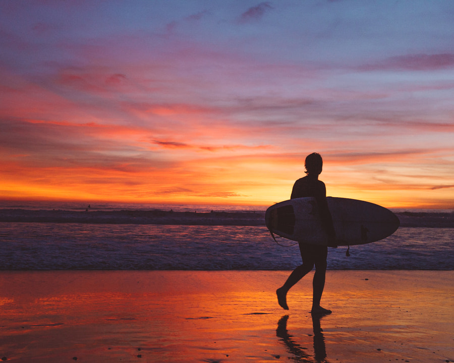 Surfer at sunset on Venice Beach by Ashley McKinney on 500px.com