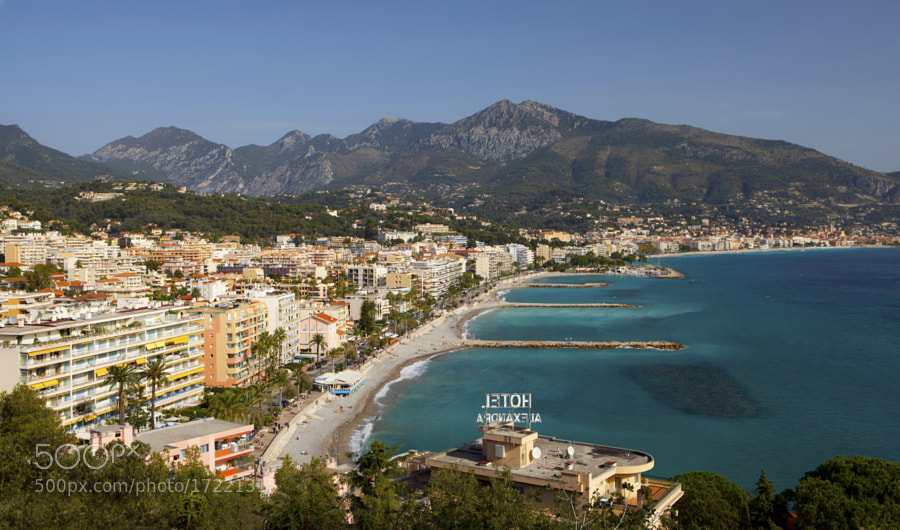 Menton, nicknamed the Pearl of France, is located on the Mediterranean Sea at the Franco-Italian border, just across from the Liguran town of Ventimiglia.