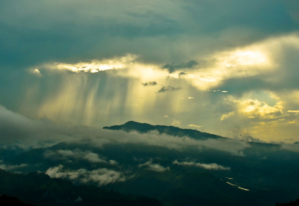 Photograph Rain being lighted by sun from behind the clouds by Rosangluaia Betlu on 500px