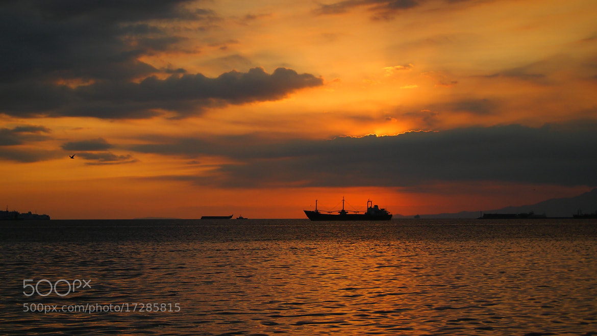 Photograph Ship in The Sunset silhouette by Tjarliman Rusadi on 500px