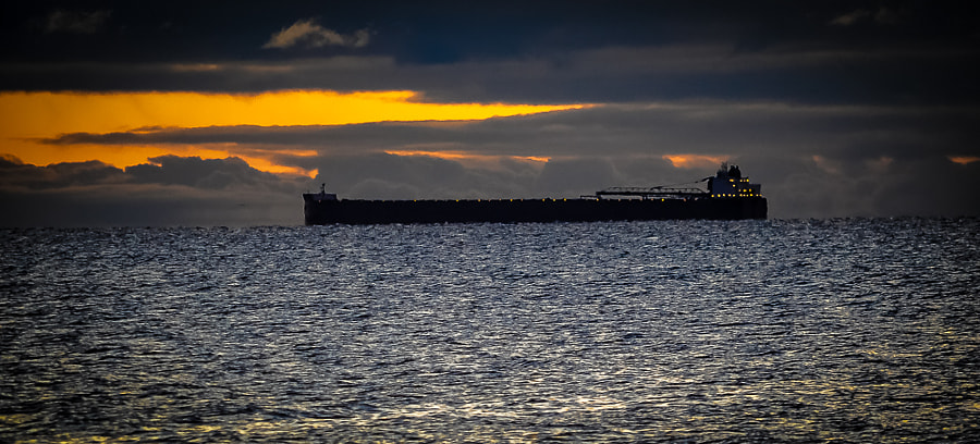There's nothing like the mystique of a long Great Lake vessel creeping silently into the rising sun.