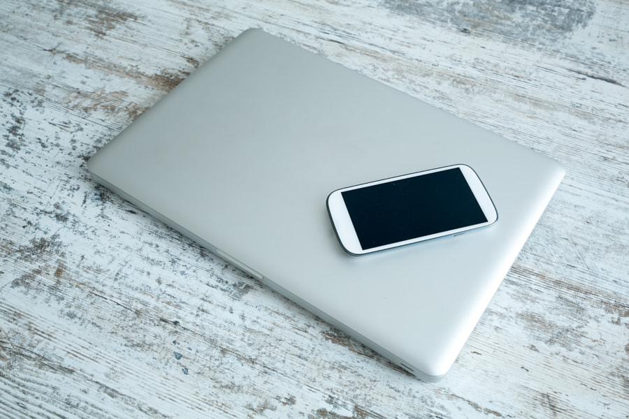 Smartphone and a laptop computer by Michael Osterrieder on 500px.com