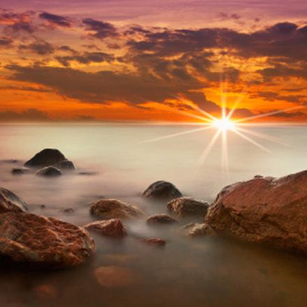 Red Sunset on foggy rocks