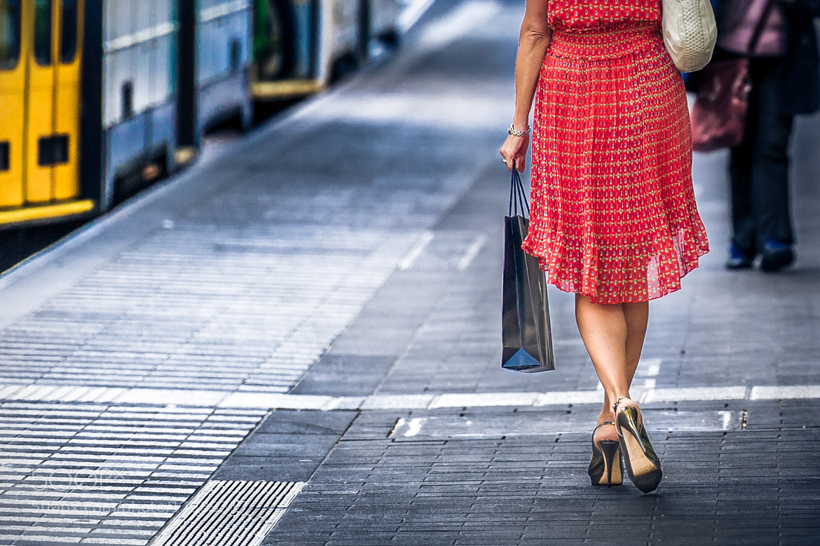 Photograph Woman in red by Alex Megremis on 500px