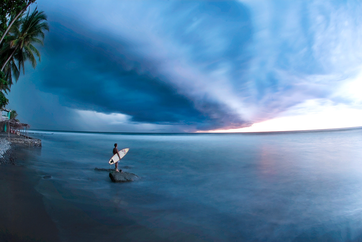 Photograph surfer watching the storm by alain denis on 500px
