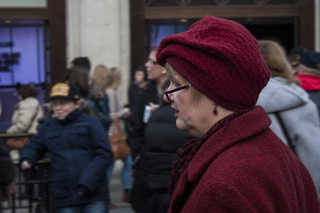 Photograph Old Woman With Red Hat by David Giraldo on 500px