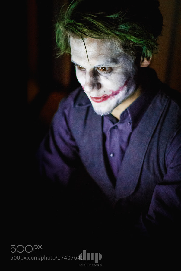 A buddy of mine who looks a lot like Heath Ledger to begin with dressed up as Joker for Halloween a couple of days ago.  He was sitting on a laptop selecting a song, so I cranked up the ISO and took a couple of shots. A lot more moody than the shots I took using flash.  Enjoy!