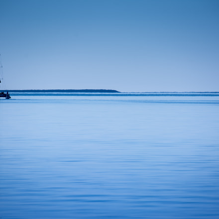 Single catamaran sailing on calm blue water at Monkey Mia Western Australia