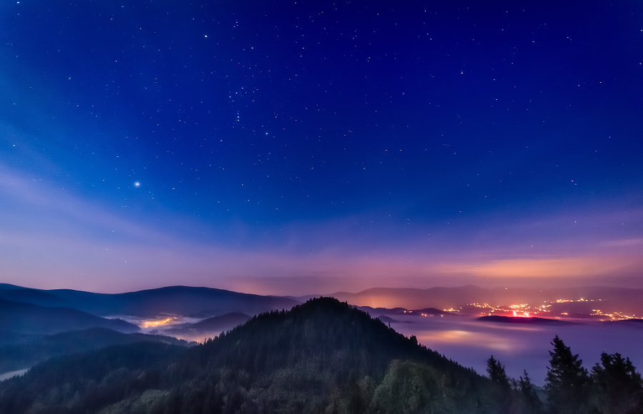 Stars over mountains and fogs