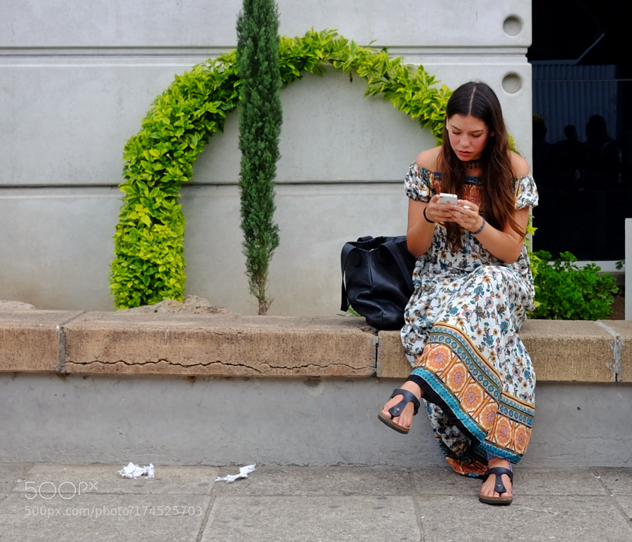 Girl looking at her phone