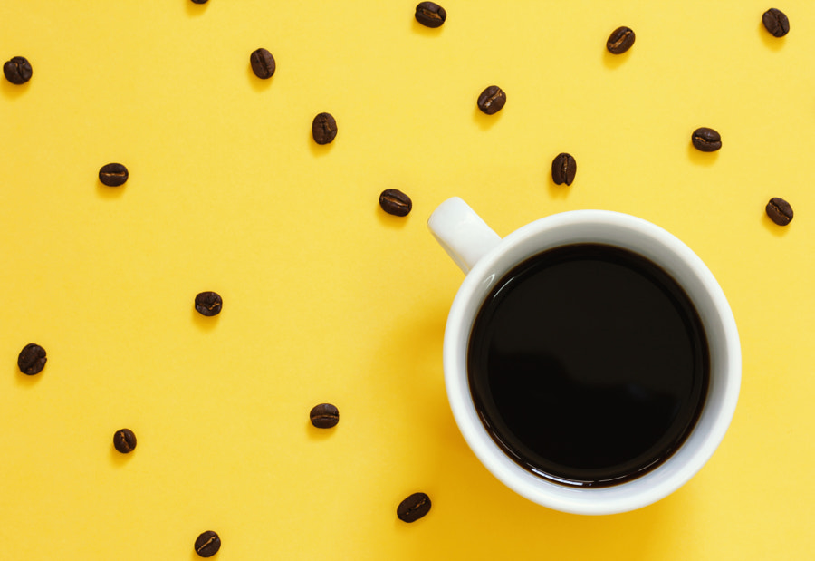 Top view of black coffee and coffee beans by Nuchy Lee on 500px.com