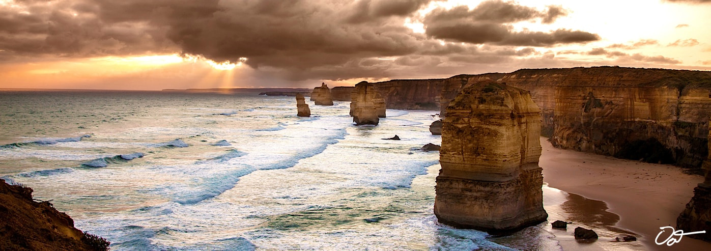 Photograph 12 Apostles Rock Formation with fog, pounding sea by Oat Vaiyaboon on 500px