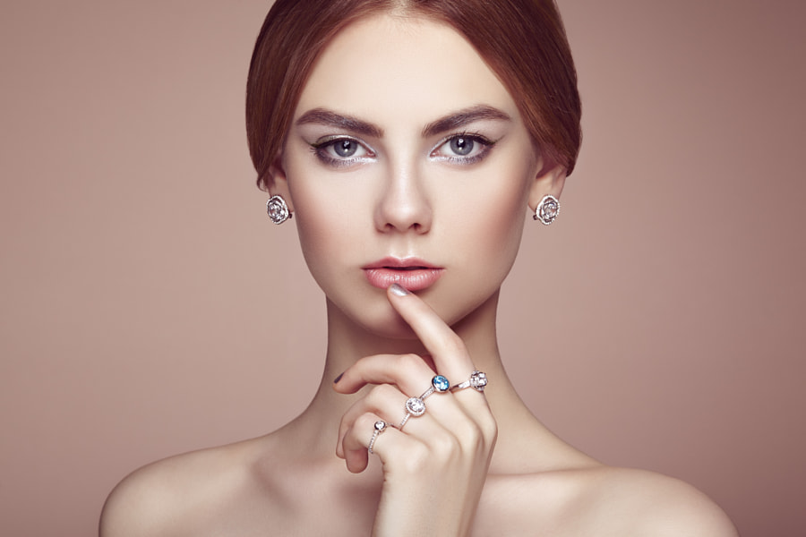 Fashion portrait of young beautiful woman with jewelry by Oleg Gekman on 500px.com