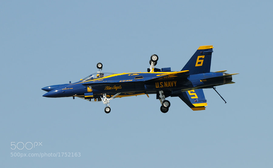 US Navy's Blue Angels Number 6 opposing solo Lieutenant C.J. Simonsen in front and upside down Number 5 lead solo Lieutenant Ben Walborn in the back performing another great way of aerobatics with there F/A-18 Hornets. Thanks in advance for viewing.