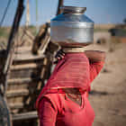 Woman carrying water in Jaisalmer desert
